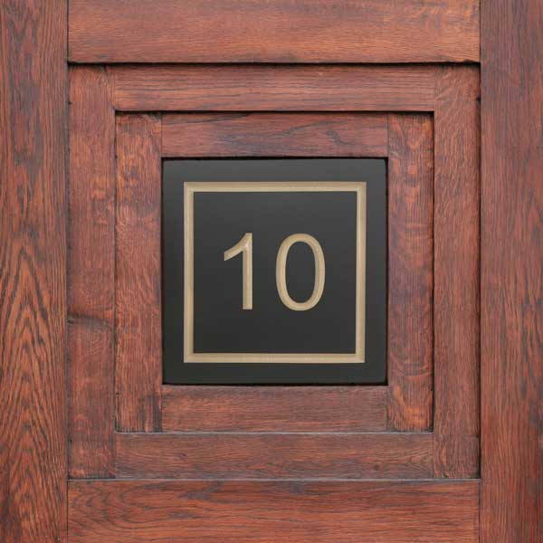 House number 10 plaque with coloured enamel inscription