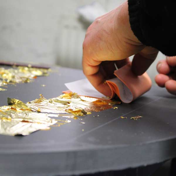 Laying the 23.5ct gold leaf