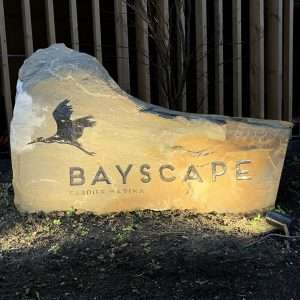 Welsh pennant boulder for Bayscape. Stone boulders with enamel inscription.