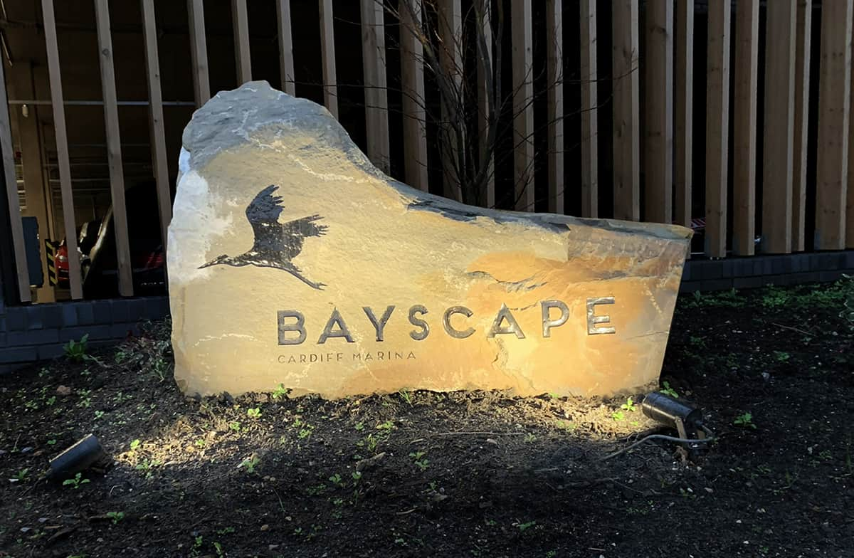 Welsh pennant boulder for Bayscape. Stone boulders with enamel inscription.