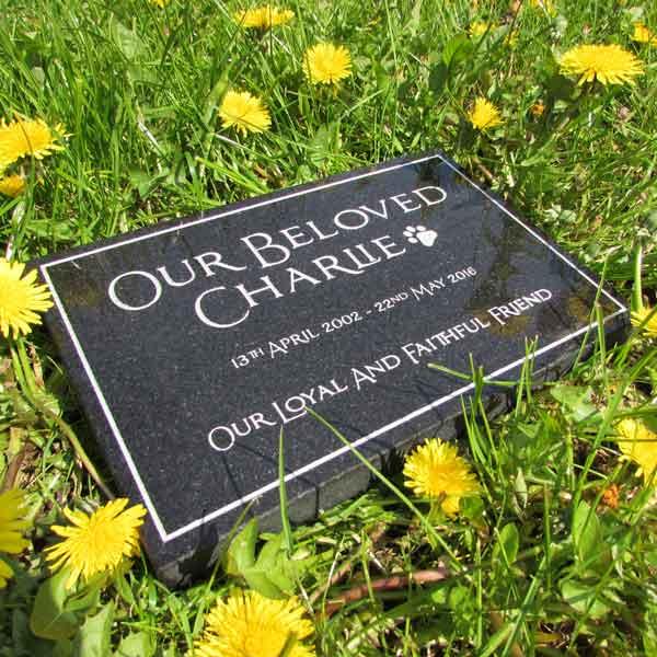 Black granite pet memorial with coloured enamel inscription