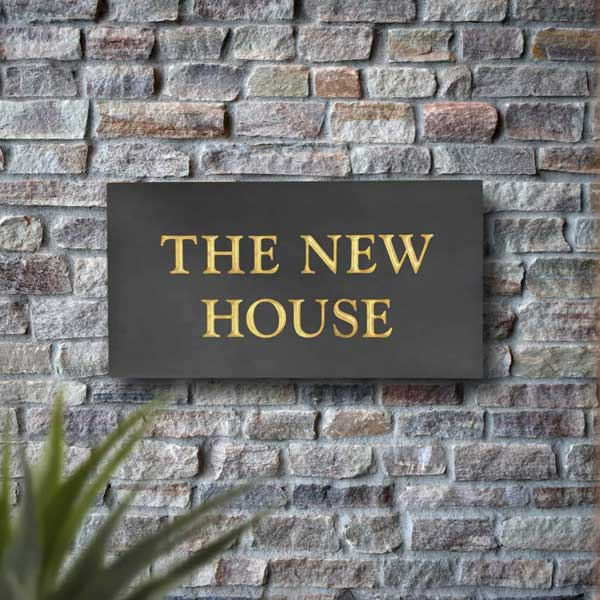The New House Welsh slate plaque with 23.5ct gold inscription
